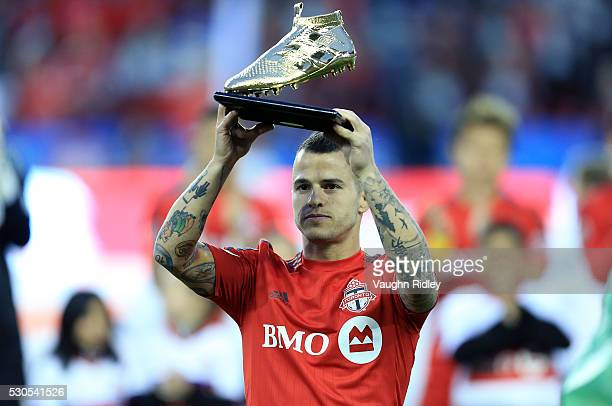 Sebastian Giovinco of Toronto FC is presented with the MLS Audi Golden Boot Award as leading scorer for the 2015 season prior to an MLS soccer game...