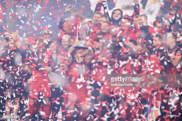 Sebastian Giovinco of Toronto FC lifts the MLS Cup trophy and celebrates with his team mates after the 2017 MLS Cup Final between Toronto FC and...