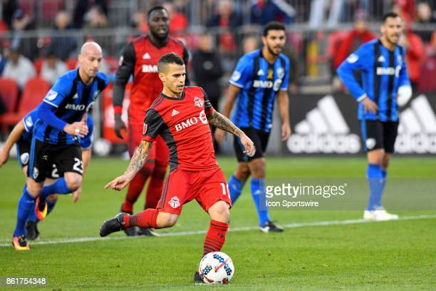 Sebastian Giovinco of Toronto FC takes a penalty kick during the first half of the MLS Soccer regular season game between Toronto FC and Montreal...