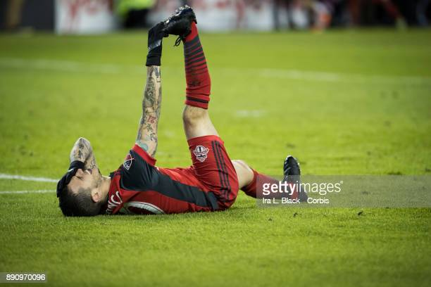 Sebastian Giovinco of Toronto FC tries to stretch out his legs after a hit during the 2017 Audi MLS Championship Cup match between Toronto FC and...