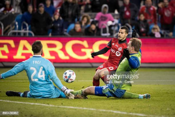 Sebastian Giovinco of Toronto FC watches as Stefan Frei of Seattle Sounders blocks his shot on goal during the 2017 Audi MLS Championship Cup match...