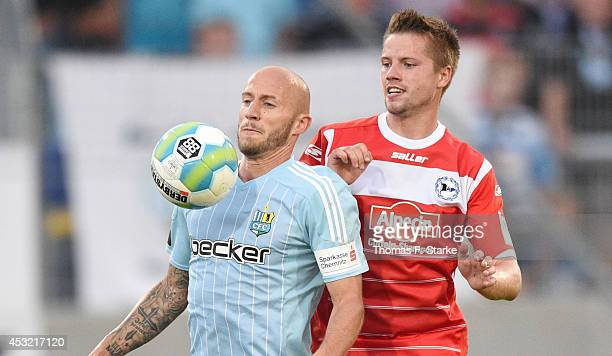 Sebastian Glasner of Chemnitz and Julian Boerner of Bielefeld fight for the ball during the Third League match between Chemnitzer FC and Arminia...