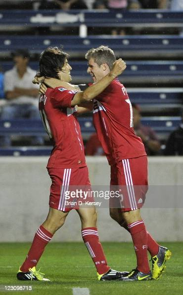 Sebastian Grazzini of the Chicago Fire and teammate Logan Pause celebrate Grazzini's penalty kick goal against the Richmond Kickers during their 2011...