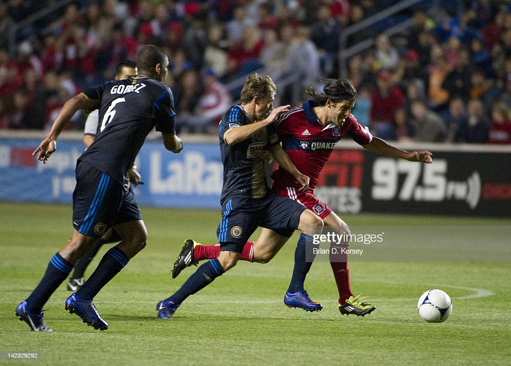 Sebastian Grazzini #10 of the Chicago Fire (R) moves the ball as Chris Albright #3 of the Philadelphia Union defends during the first half at Toyota Park on March 24, 2012 in Bridgeview, Illinois. The Fire won 1-0.
