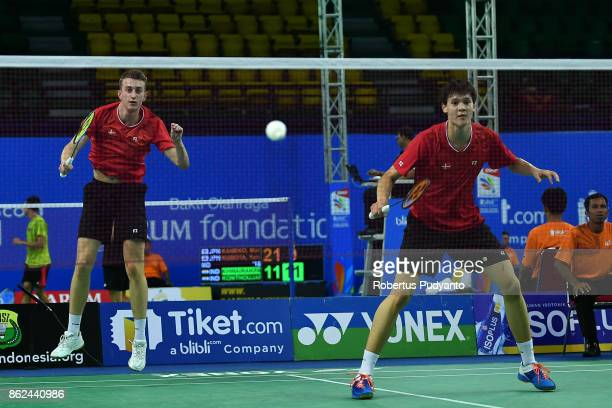 Sebastian Gronbjerg and Daniel Lundgaard of Denmark compete against Oscar Guo and Dacmen Vong of New Zealand during Men's Doubles qualification round...