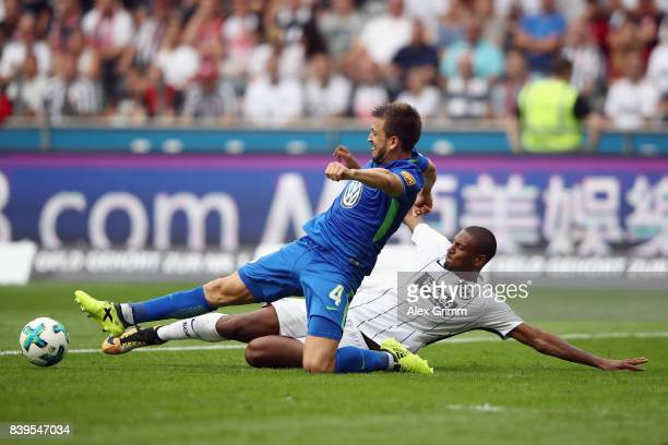 Sebastian Haller of Frankfurt is challenged by Ignacio Camacho of Wolfsburg during the Bundesliga match between Eintracht Frankfurt and VfL Wolfsburg...