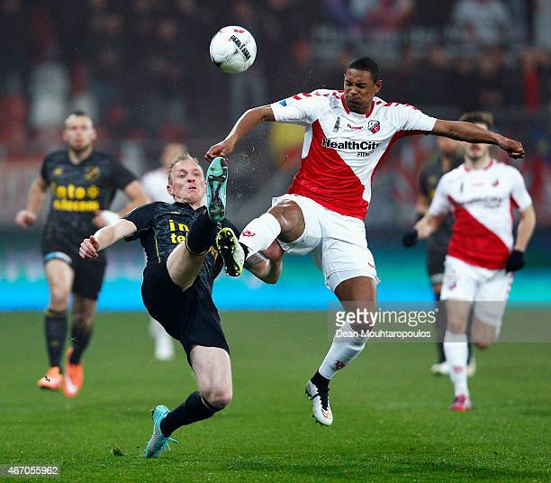 Sebastian Haller of Utrecht and Henrico Drost of NAC battle for the ball during the Dutch Eredivisie match between FC Utrecht and NAC Breda held at...