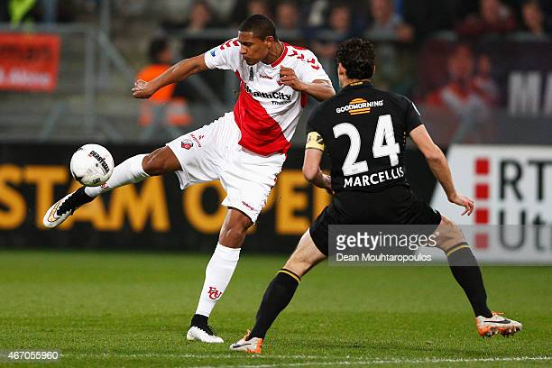Sebastian Haller of Utrecht shoots on goal in front of Dirk Marcellis of NAC during the Dutch Eredivisie match between FC Utrecht and NAC Breda held...