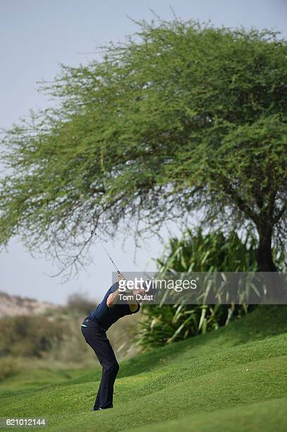 Sebastian Heisele of Germany hits an approach shot during day three of the NBO Golf Classic Grand Final at Al Mouj Golf on November 4 2016 in Muscat...