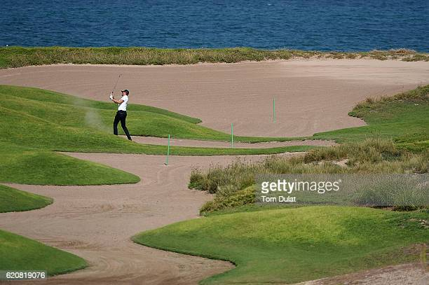 Sebastian Heisele of Germany hits from a bunker on the 11th hole during day two of the NBO Golf Classic Grand Final at Al Mouj Golf on November 3...