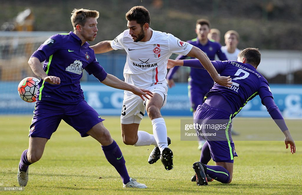 Sebastian Hertner and Julian Riedel of Aue are challenged by Nejmeddin Daghfous of Wuerzburg during the Third League match between FC Erzgebirge Aue and Wuerzburger Kickers at Erzgebirgsstadium on February 14, 2016 in Aue, Germany.