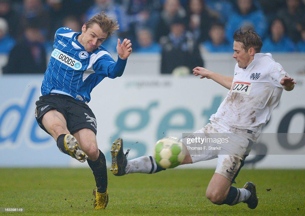 Sebastian Hille (L) of Bielefeld and Fabian Hergesell of Muenster fight for the ball during the Third League match between Arminia Bielefeld and Preussen Muenster at Schueco Arena on March 9, 2013 in Bielefeld, Germany.