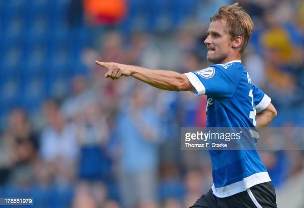 Sebastian Hille of Bielefeld celebrates scoring his teams first goal during the DFB Cup first round match between Arminia Bielefeld and Eintracht...
