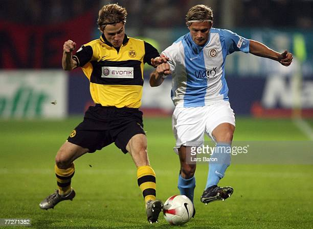Sebastian Hille of Dortmund in action with Robert Paul of WehenWiesbaden during the friendly match between SV WehenWiesbaden and Borussia Dortmund at...