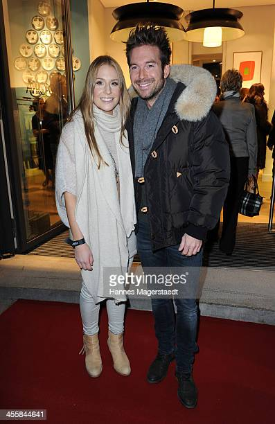Sebastian Hoeffner and his girlfriend Patricia Hoepp attend Apropos Concept Store Opening on December 12 2013 in Munich Germany