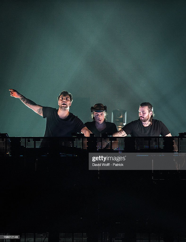Sebastian Ingrosso, Axwell and <a gi-track='captionPersonalityLinkClicked' href=/galleries/search?phrase=Steve+Angello&family=editorial&specificpeople=5737645 ng-click='$event.stopPropagation()'>Steve Angello</a> from Swedish House Mafia perform at Palais Omnisports de Bercy on December 8, 2012 in Paris, France.