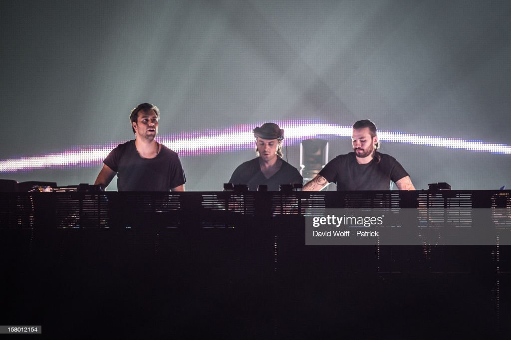 Sebastian Ingrosso, Axwell and Steve Angello from Swedish House Mafia perform at Palais Omnisports de Bercy on December 8, 2012 in Paris, France.