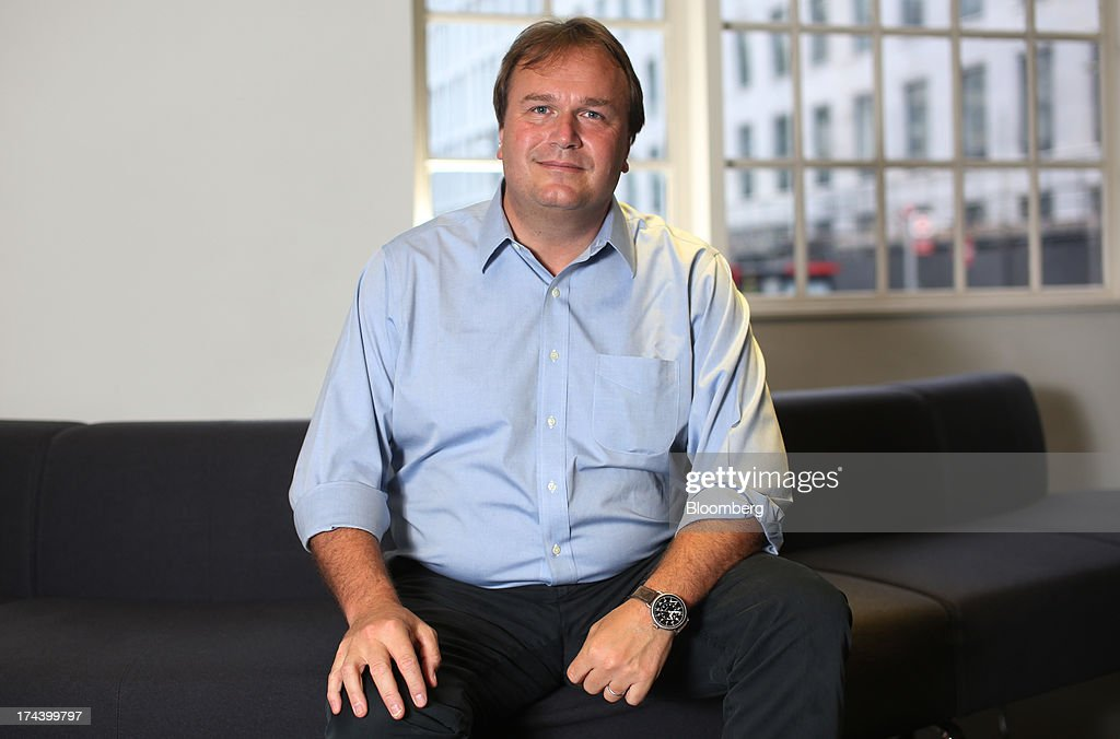Sebastian James, chief executive officer of Dixons Retail Plc, poses for a photograph in London, U.K. on Thursday, July 25, 2013. The owner of the PC World and Currys chains is training staff to improve customer relations and is selling higher-margin services to overcome cheaper online competitors. Photographer: Chris Ratcliffe/Bloomberg via Getty Images