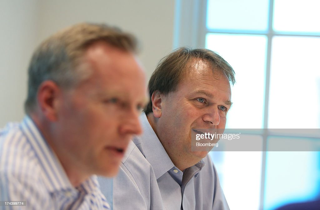 Sebastian James, chief executive officer of Dixons Retail Plc, right, and Humphrey Singer, group finance director of Dixons Retail Plc, speak during an interview in London, U.K. on Thursday, July 25, 2013. The owner of the PC World and Currys chains is training staff to improve customer relations and is selling higher-margin services to overcome cheaper online competitors. Photographer: Chris Ratcliffe/Bloomberg via Getty Images