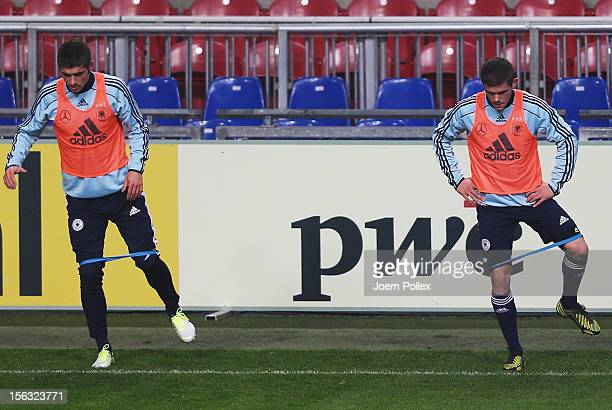 Sebastian Jung and Roman Neustaedter of Germany exercise during a training session on the eve of their friendly international match against the...