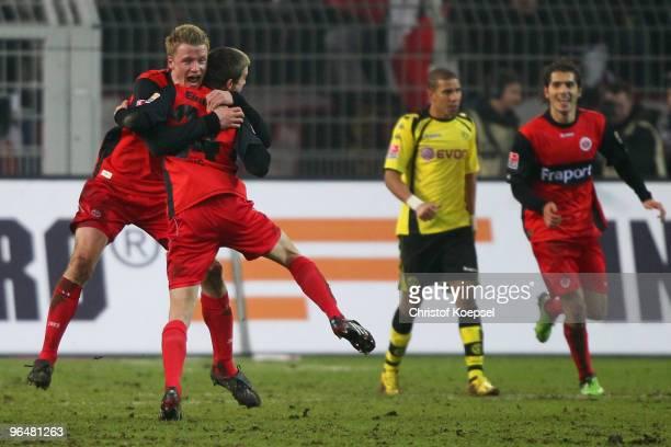 Sebastian Jung of Frankfurt celebrates the second goal with Maik Franz during the Bundesliga match between Borussia Dortmund and Eintracht Frankfurt...