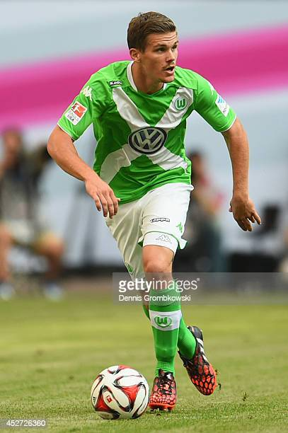 Sebastian Jung of VfL Wolfsburg controls the ball during the Telekom Cup 2014 match between Hamburger SV and VfL Wolfsburg at Imtech Arena on July 26...