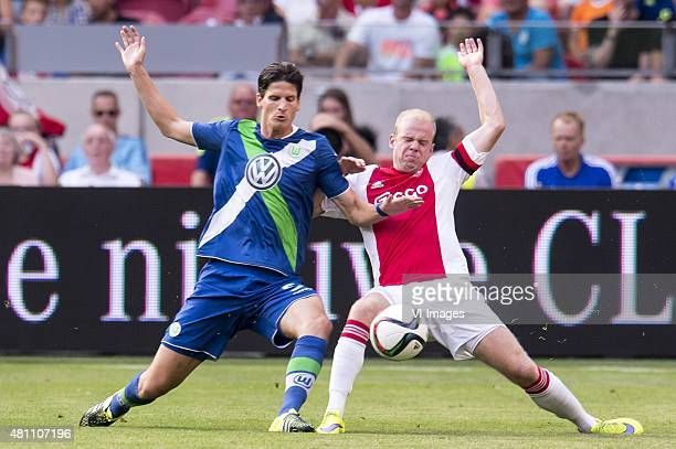 Sebastian Jung of VFL Wolfsburg Davy Klaassen of Ajax during the preseason friendly match between Ajax Amsterdam and VfL Wolfsburg on July 17 2015 at...