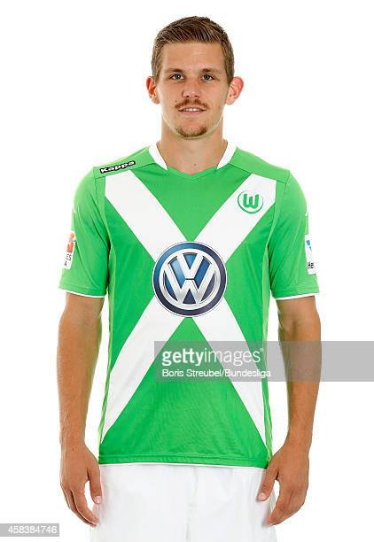 Sebastian Jung of VfL Wolfsburg poses during the team presentation on July 30 2014 at Volkswagen Arena in Wolfsburg Germany