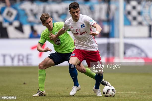 Sebastian Jung of Wolfsburg and Filip Kostic of Hamburg battle for the ball during the Bundesliga match between Hamburger SV and VfL Wolfsburg at...