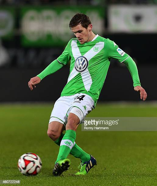 Sebastian Jung of Wolfsburg controls the ball during the Bundesliga match between VfL Wolfsburg and 1 FC Koeln at Volkswagen Arena on December 20...