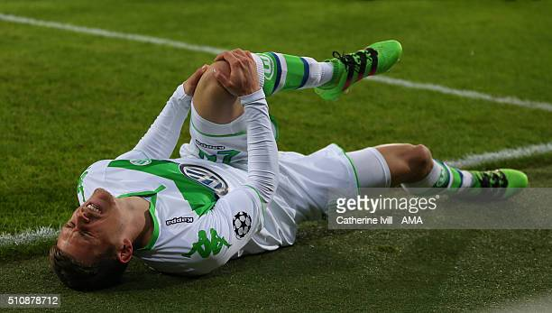 Sebastian Jung of Wolfsburg injures his left knee in the first half of the UEFA Champions League match between KAA Gent and VfL Wolfsburg at Ghelamco...