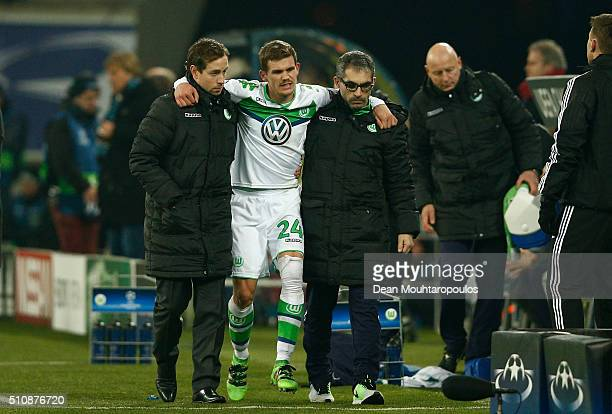 Sebastian Jung of Wolfsburg leaves the pitch due to injury during the UEFA Champions League round of 16 first leg match between KAA Gent and VfL...