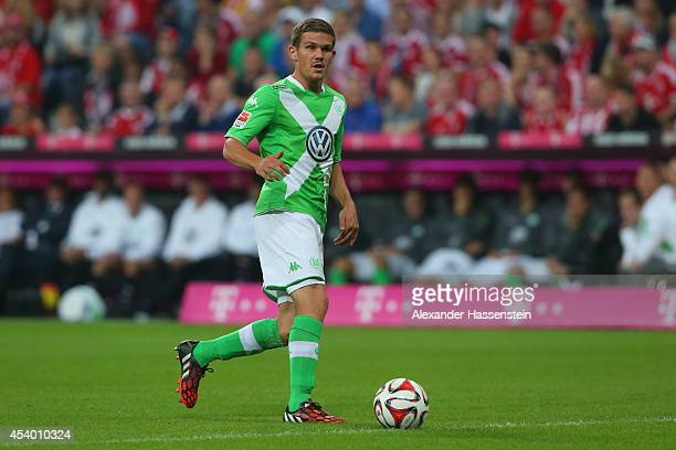 Sebastian Jung of Wolfsburg runs with the ball during the Bundesliga match between FC Bayern Muenchen and VfL Wolfsburg at Allianz Arena on August 22...