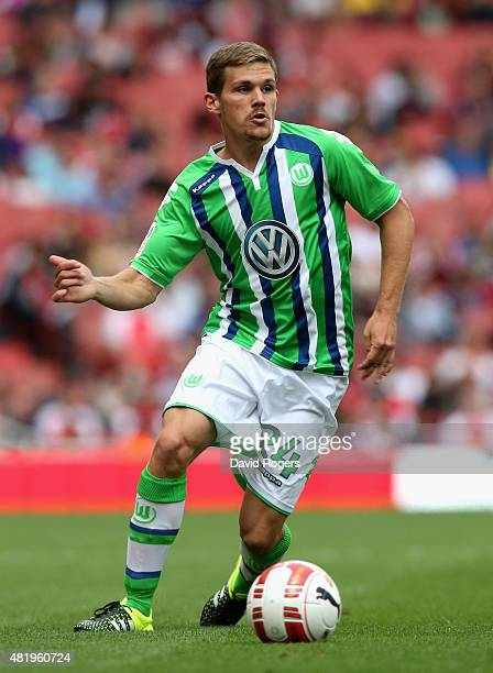 Sebastian Jung of Wolfsburg runs with the ball during the Emirates Cup match between VfL Wolfsburg and Villareal at the Emirates Stadium on July 25...