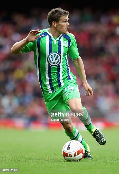 Sebastian Jung of Wolfsburg runs with the ball during the Emirates Cup match between Arsenal and VfL Wolfsburg at the Emirates Stadium on July 26...