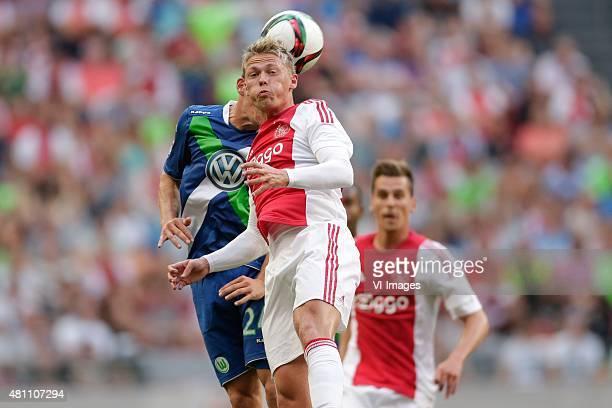 Sebastian Jung of Wolfsburg Viktor Fischer of Ajax during the preseason friendly match between Ajax Amsterdam and VfL Wolfsburg on July 17 2015 at...