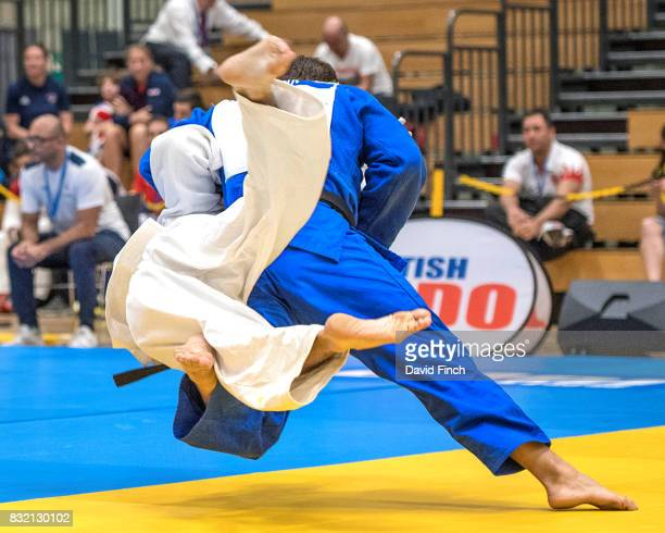 Sebastian Junk of Germany throws Federico Dura of Italy with a sweeping hip throw for ippon to win their u81kgs repechage contest during the IBSA VI...