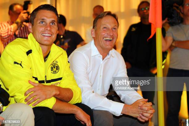 Sebastian Kehl and Chairman HansJoachim Watzke chairman of Borussia Dortmund laugh during the Borussia Dortmund Puma kit launch at Westfaelischer...
