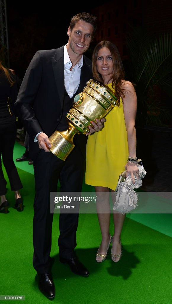 Sebastian Kehl and his girlfriend Tina pose with the cup during the Borussia Dortmund party at the Ewerk on May 13, 2012 in Berlin, Germany.