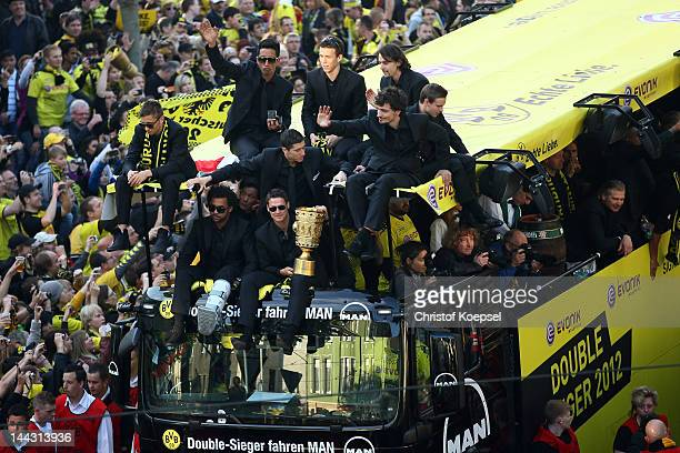 Sebastian Kehl holds the DFB tropy and celebrates with his team during a parade at Borsigplatz celebrating Borussia Dortmund's Bundesliga and DFB Cup...