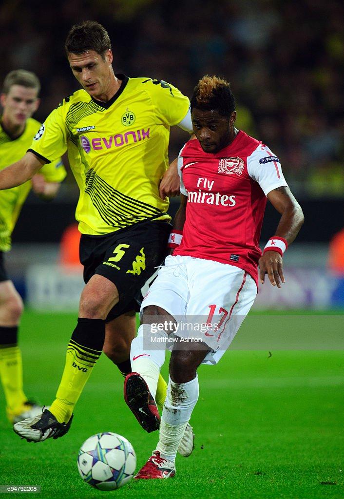Sebastian Kehl of Borussia Dortmund and Alexandre Song of Arsenal