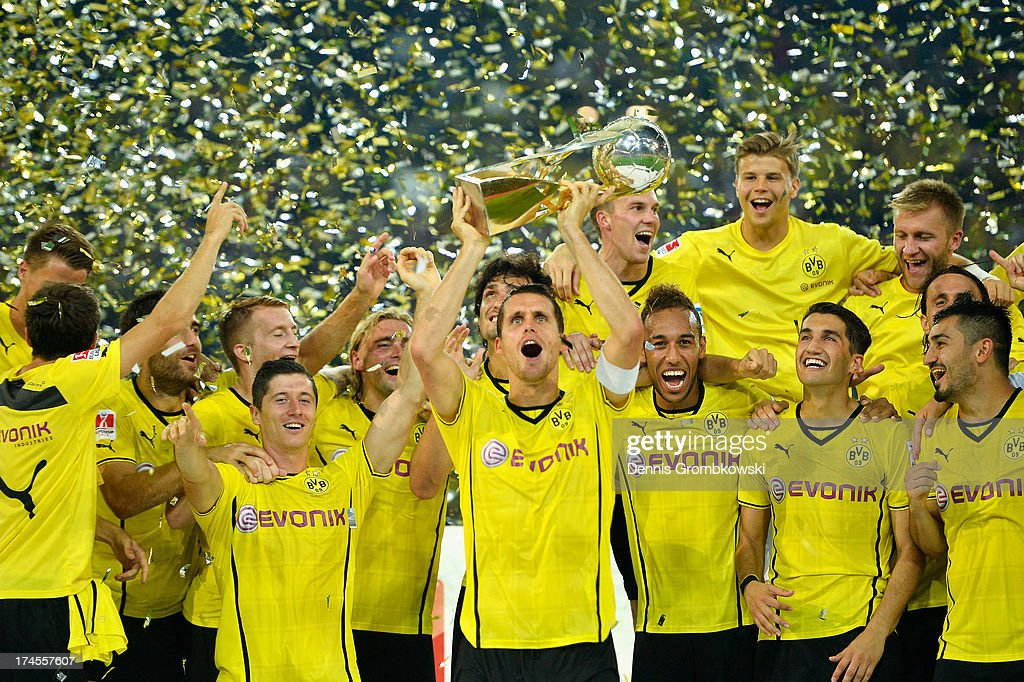 <a gi-track='captionPersonalityLinkClicked' href=/galleries/search?phrase=Sebastian+Kehl&family=editorial&specificpeople=486611 ng-click='$event.stopPropagation()'>Sebastian Kehl</a> of Borussia Dortmund lifts the trophy after the DFL Supercup match between Borussia Dortmund and FC Bayern Muenchen at Signal Iduna Park on July 27, 2013 in Dortmund, Germany.