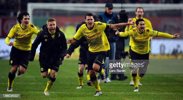 Sebastian Kehl of Dortmund and his team mates Mats Hummels Jakub Blaszczykowski and Ilkay Guendogan celebrate after winning the DFB Cup third round...