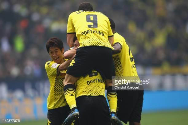Sebastian Kehl of Dortmund celebrates the second goal with Shinji Kagawa Robert Lewandowski and Felipe Santana of Dortmund during the Bundesliga...