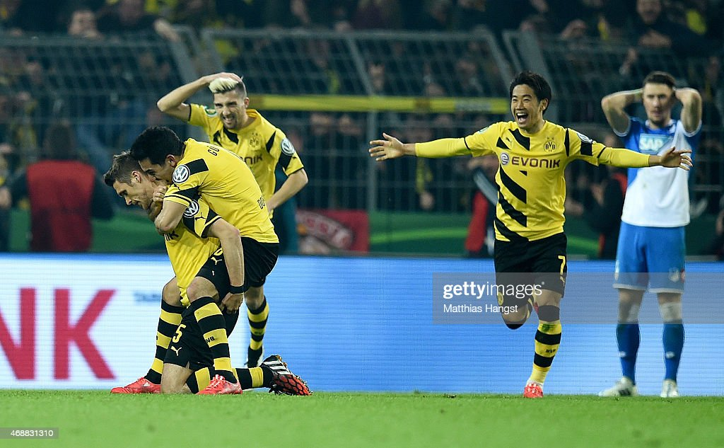 <a gi-track='captionPersonalityLinkClicked' href=/galleries/search?phrase=Sebastian+Kehl&family=editorial&specificpeople=486611 ng-click='$event.stopPropagation()'>Sebastian Kehl</a> of Dortmund celebrates with his team-mates after scoring his team's third goal during the DFB Cup Quarter Final match between Borussia Dortmund and 1899 Hoffenheim at Signal Iduna Park on April 7, 2015 in Dortmund, Germany.