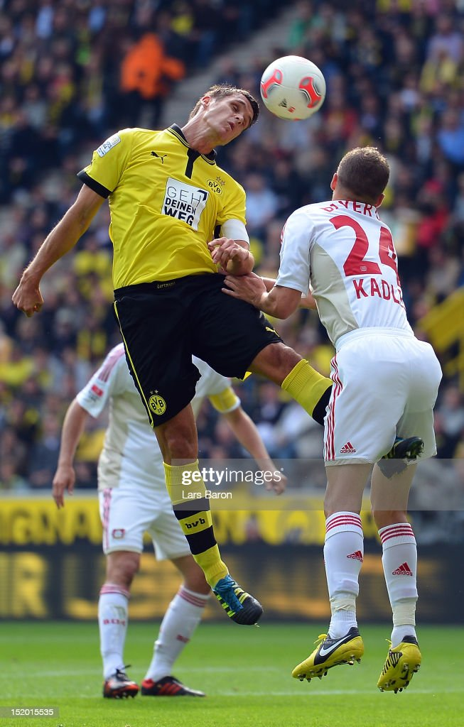 <a gi-track='captionPersonalityLinkClicked' href=/galleries/search?phrase=Sebastian+Kehl&family=editorial&specificpeople=486611 ng-click='$event.stopPropagation()'>Sebastian Kehl</a> of Dortmund goes up for a header with <a gi-track='captionPersonalityLinkClicked' href=/galleries/search?phrase=Michal+Kadlec&family=editorial&specificpeople=2156641 ng-click='$event.stopPropagation()'>Michal Kadlec</a> of Leverkusen during the Bundesliga match between Borussia Dortmund and Bayer 04 Leverkusen at Signal Iduna Park on September 15, 2012 in Dortmund, Germany.