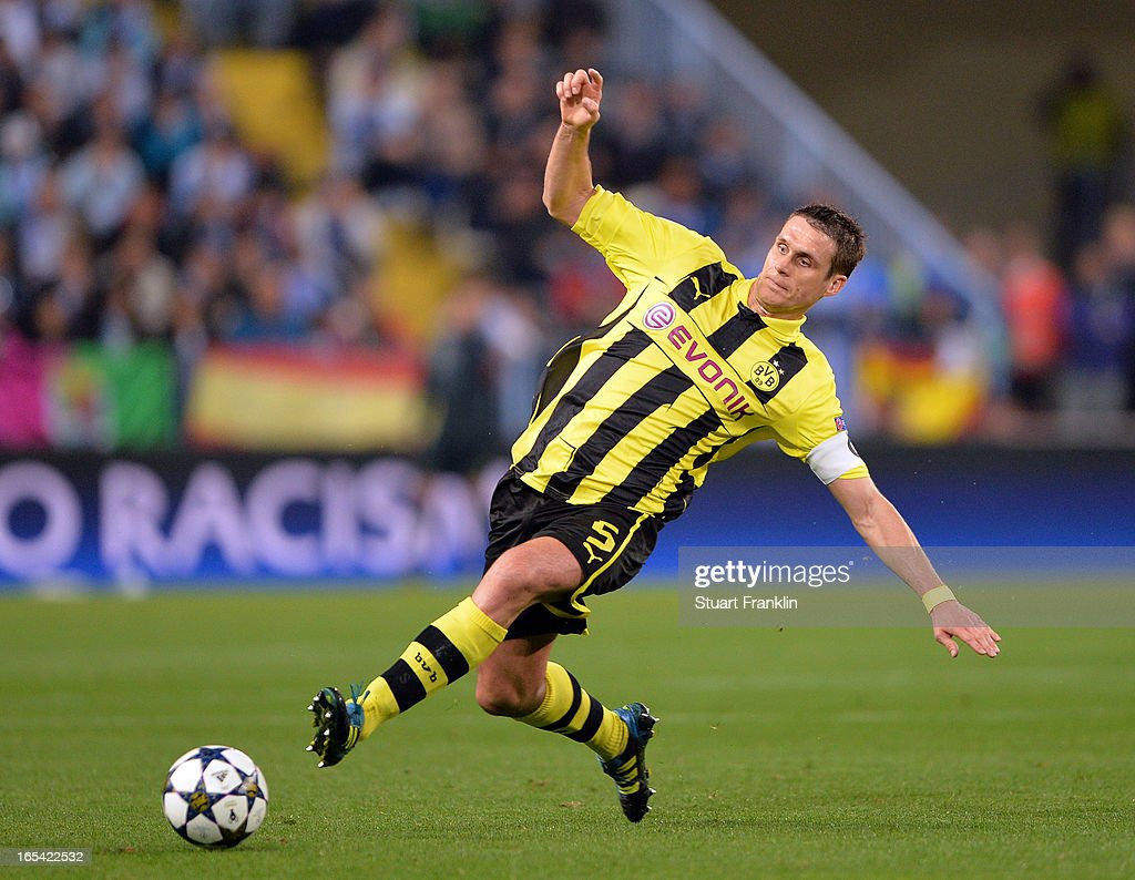 <a gi-track='captionPersonalityLinkClicked' href=/galleries/search?phrase=Sebastian+Kehl&family=editorial&specificpeople=486611 ng-click='$event.stopPropagation()'>Sebastian Kehl</a> of Dortmund in action during the UEFA Champion League quarter final first leg match between Malaga CF and Borussia Dortmund at La Rosaleda Stadium on April 3, 2013 in Malaga, Spain.