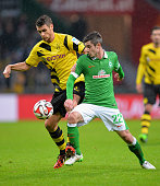 Sebastian Kehl of Dortmund is challenged by Fin Bartels of Bremen during the Bundesliga match between SV Werder Bremen and Borussia Dortmund at...