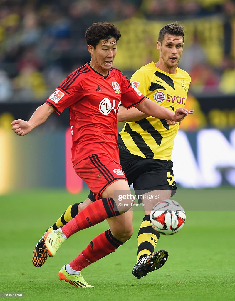 <a gi-track='captionPersonalityLinkClicked' href=/galleries/search?phrase=Sebastian+Kehl&family=editorial&specificpeople=486611 ng-click='$event.stopPropagation()'>Sebastian Kehl</a> of Dortmund is challenges <a gi-track='captionPersonalityLinkClicked' href=/galleries/search?phrase=Heung-Min+Son&family=editorial&specificpeople=7118687 ng-click='$event.stopPropagation()'>Heung-Min Son</a> of Leverkusen during the Bundesliga match between Borussia Dortmund and Bayer 04 Leverkusen at Signal Iduna Park on August 23, 2014 in Dortmund, Germany.