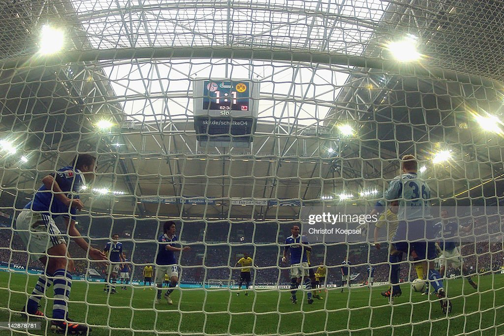 Sebastian Kehl of Dortmund scores the second goal against Lars UnnerstalL of Schalke during the Bundesliga match between FC Schalke 04 and Borussia...